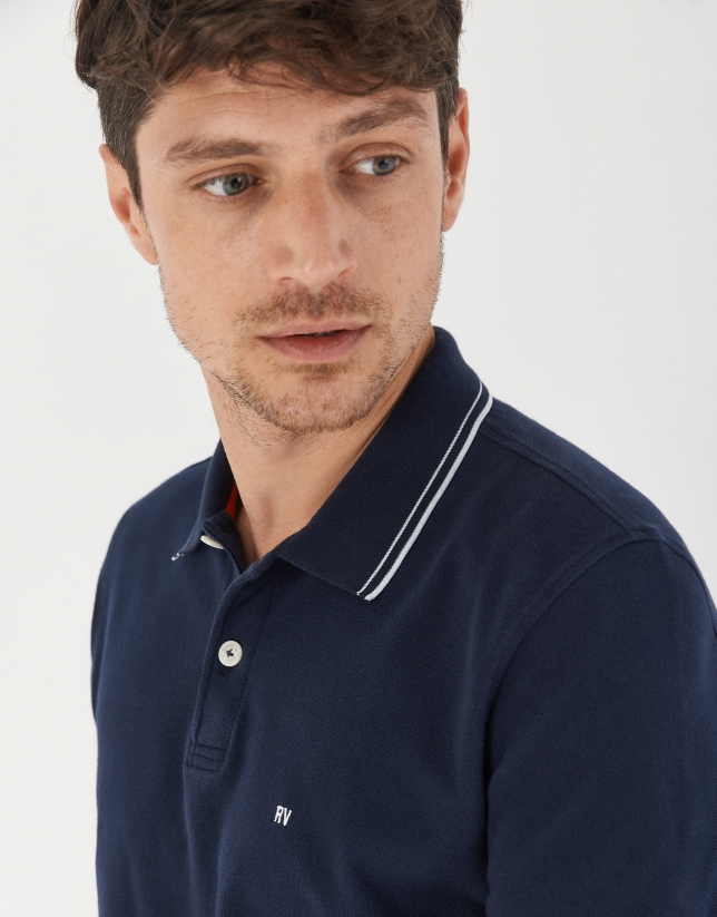 Navy blue pique cotton polo shirt with white outlines