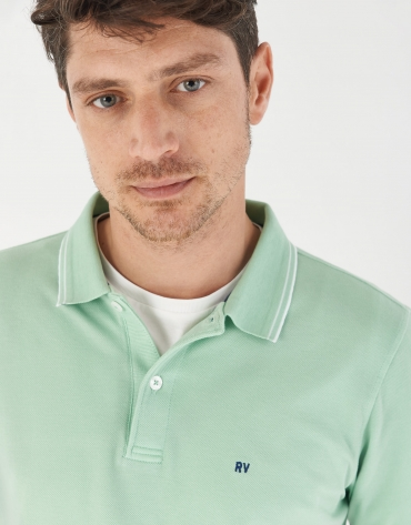 Green pique cotton polo shirt with white outlines