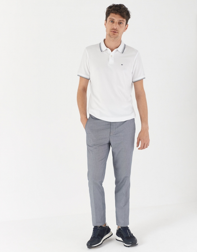 White pique cotton polo shirt with navy blue outlines