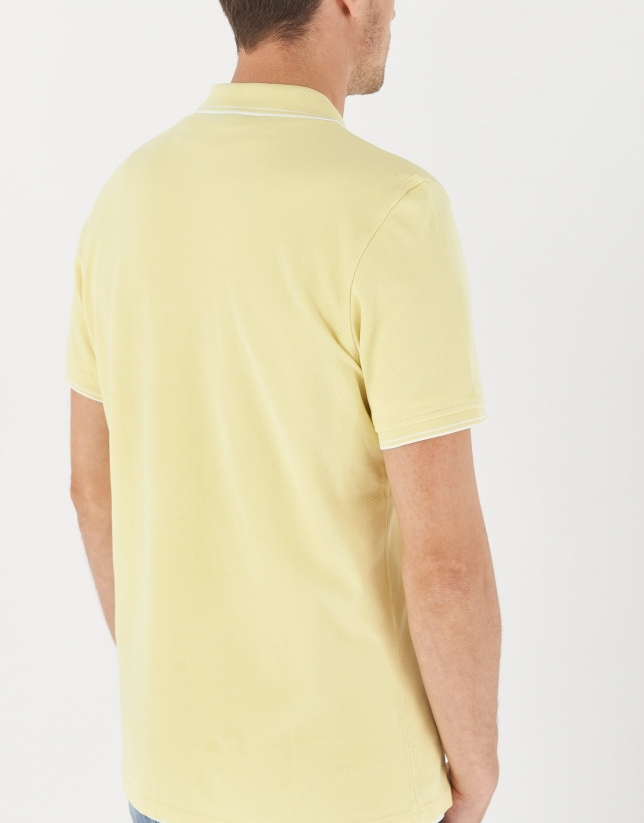 Yellow pique cotton polo shirt with white outlines