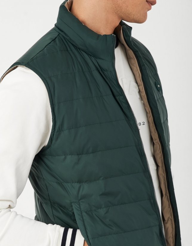 Green and light brown reversible vest with down quilting