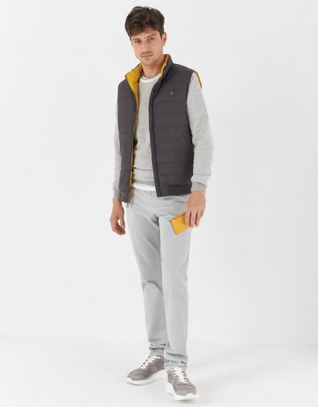 Chaleco reversible acolchado plumas gris/amarillo
