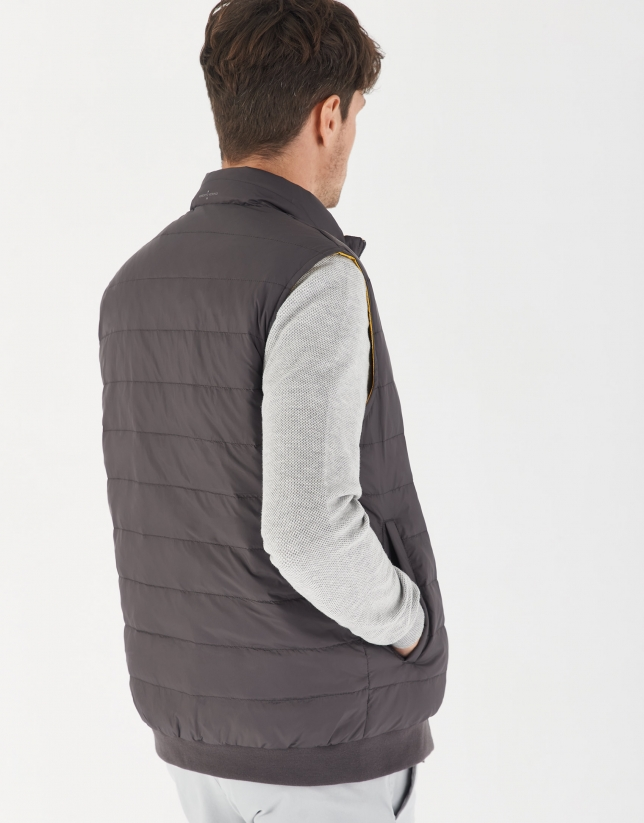 Gray and yellow brown reversible vest with down quilting