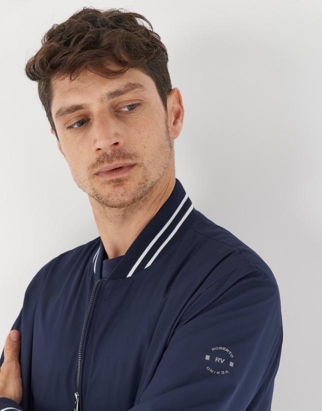Navy blue bomber jacket with white lines
