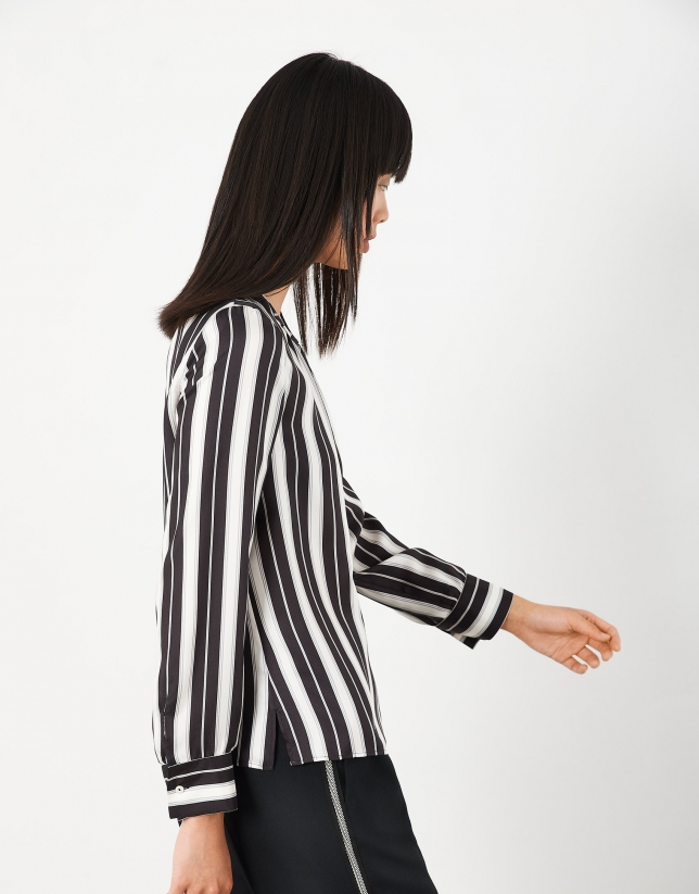 Black and white striped blouse with round neckline