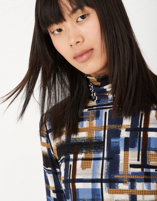 Blue knit top with raised collar and blue print design
