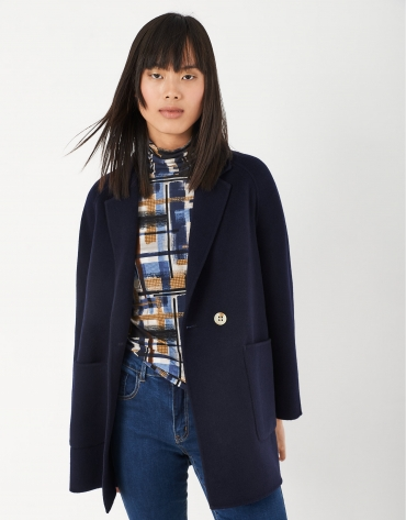 Short navy blue coat with double row of buttons