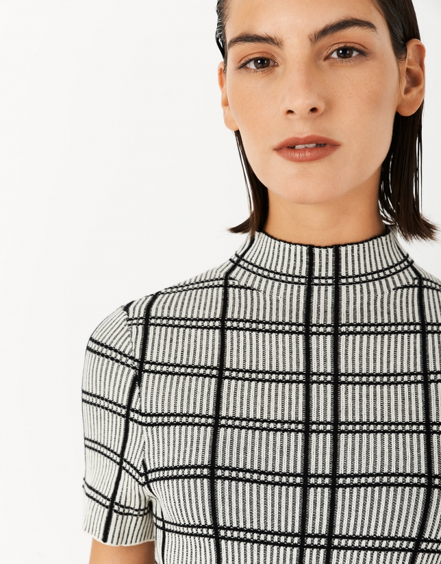 Black and white checked knit sweater with short sleeves