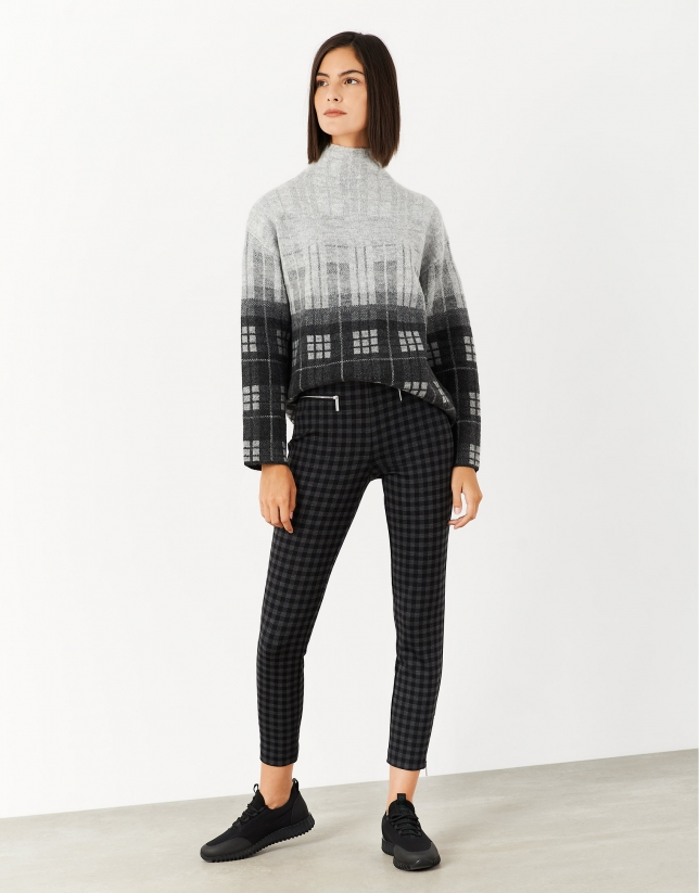 Gray and black checked knit sweater with high collar
