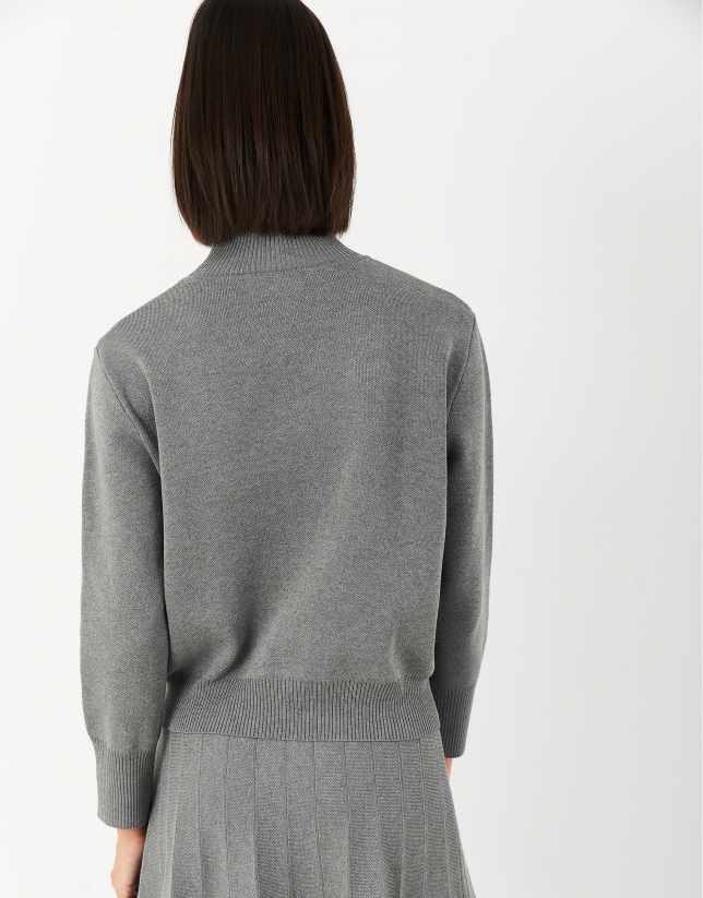 Gray sweater with raised collar and pockets