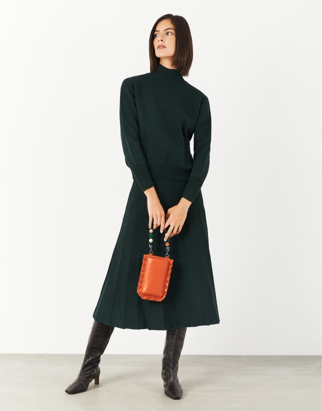 Green sweater with raised collar and pockets