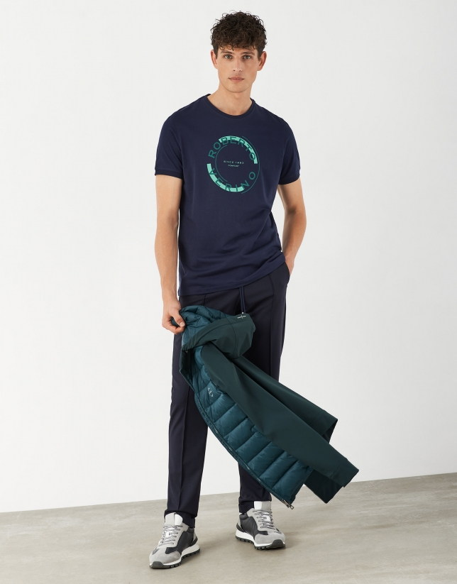 Blue cotton top with rounded green logo
