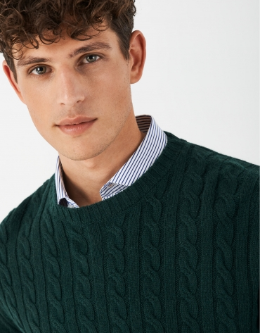 Green cable-stitched sweater