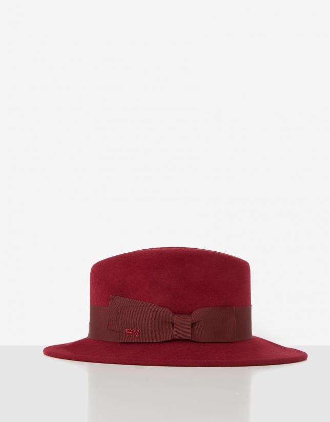 Red felt fedora hat with maroon ribbon