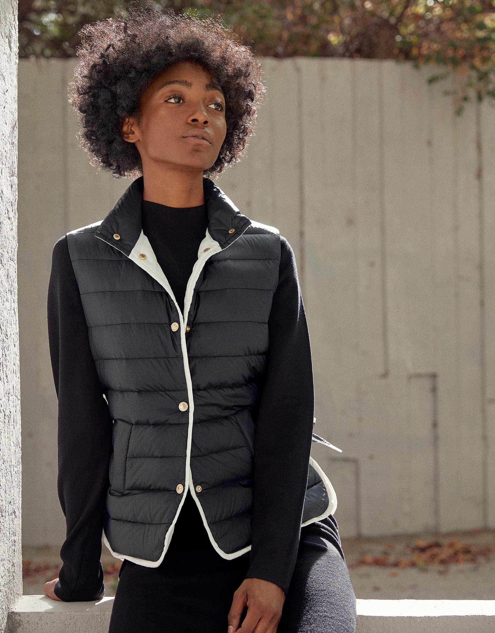 Black high collar quilted vest
